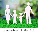family from paper on grass on... | Shutterstock . vector #149354648