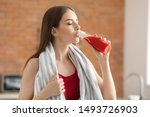 Young Sporty Woman Drinking...
