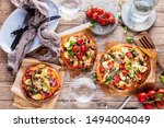 fresh selfmade mini pizza on... | Shutterstock . vector #1494004049