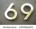 golden number 69 sixty nine isolated on black wall texture. stone background. 69 Kama Sutra poses