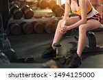 Small photo of Woman exercise workout in gym fitness breaking relax and stranglehold after training sport with dumbbell lifestyle bodybuilding, Athlete builder muscles lifestyle.