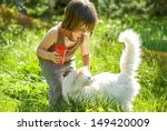 Stock photo kid playing with a cat 149420009
