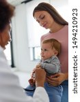 Female Doctor Pediatrician With ...