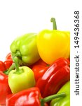 Multi-colour peppers on a white background. - stock photo