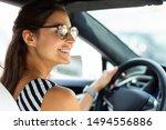 beautiful woman driving.... | Shutterstock . vector #1494556886