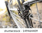 A Padlock On A Steel Chain Link ...