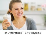 Smiling Young Woman Drinking...