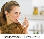 young housewife drinking water... | Shutterstock . vector #149482910