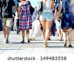 Mlotion blured pedestrians on zebra crossing - stock photo