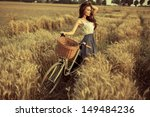 Woman With Bike Resting On...