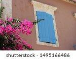 Blue Window Shutters On House...