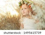 Little Girl With Flowers On He...