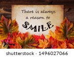 Small photo of Old Paper With Quote Always A Reason To Smile, Colorful Leaves Decoration