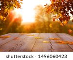Small photo of Autumn maple leaves on wooden table.Falling leaves natural background.