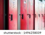 Row of red metal lockers in...