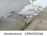 Water Drains Into A Storm Drain ...