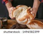 Woman Breaking Fresh Bread ...