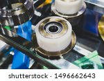Small photo of Metal bearing. Spare parts for machinery. Steel bearing with balls. Composition with bearings.