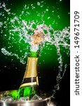 splashing champagne on a green... | Shutterstock . vector #149671709