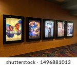 Small photo of Honolulu - August 16, 2018: Row of movie posters including Papillon, the House with a Clock in it's Wall, Peppermint, The Bookshop, and Puzzle on wall located outside the movie theater.
