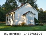 Little, old country church from the 1800s. Small white building.
