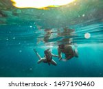 Father And Daughter Snorkeling...