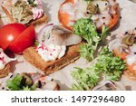 Stock photo delicious canapes with herring macro of delicious canape or sandwiches with fresh herring black 1497296480