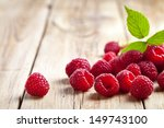 raspberries with leaf on wooden ... | Shutterstock . vector #149743100