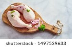 Two Raw Chicken Drumsticks With ...