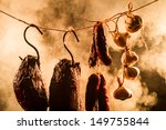 Smoked ham in a traditional way in the smokehouse - stock photo
