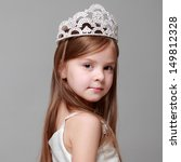Young Girl Wearing A Crown And...