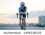 Young Woman Cyclist Riding Road ...