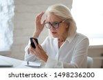 Confused Senior Businesswoman...