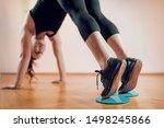 Female athlete exercising with...