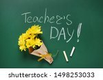 Flat lay composition with flowers and inscription TEACHER