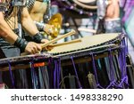 A Drummer Is Performing On The...