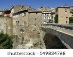 Single-arched Roman bridge over the Ouveze river in the town Vaison la Romaine , Haut Vaucluse, France - stock photo