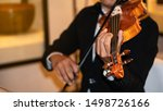 Small photo of The front view of musicians fiddling in songs
