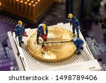miniature worker wokring on bitcoin , halving concept