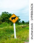Small photo of A road cautionary sign for animal crossing
