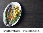 Stock photo spanish dish oven roasted in a foil mackerel stuffed with garlic lemon and herbs with cumin and 1498886816