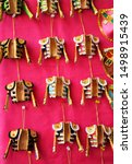 Small photo of Seville, Spain - Apr 21, 2013: Small gifts and souvenirs for tourists of bullfighting symbology on a red textile background