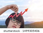 Small photo of little girl with glasses holding upside growing declining arrows graph