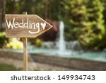 Stock photo wedding decor wooden plaque with the inscription wedding wedding on a plate green background and 149934743