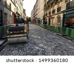 Small photo of Paris, France - 08/31/2019 : A small road roller to tamp the cobblestones of a street in Montmartre
