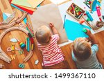 Small photo of Kids draw and make crafts. Children with educational toys and school supplies for creativity. Background for preschool and kindergarten or art classes. Boy and girl play at home or daycare