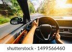 hands of car driver on steering ... | Shutterstock . vector #1499566460