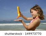 child applying sunscreen on the ... | Shutterstock . vector #149973770