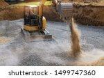 Excavator Bucket Moving Gravel...