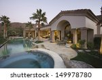 luxury swimming pool and house...   Shutterstock . vector #149978780